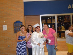 My mom, my sisters, and I at my mother's high school graduation. My mother went back to school at the age of 52 to get her high school diploma.